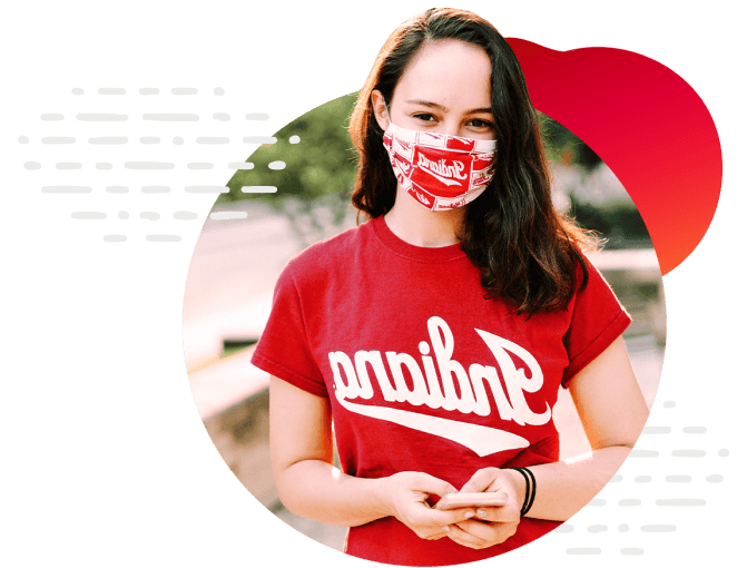 IU student wearing a face mask facing camera, framed in circle with red circle and dotted graphic design details